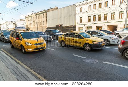 Moscow, Russia - July 24. 2017. Taxi Company Yandex And Uber Rides On Prospekt Mira Street
