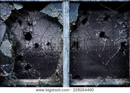 Shattered Glass Windows With Bullet Holes And Broken Pieces