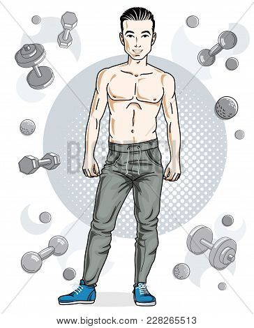 Confident Handsome Brunet Young Man Is Standing On Simple Background With Dumbbells And Barbells. Ve