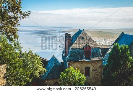 Houses Inside Walls Of Le Mont Saint-michel Island Famous For Its Low Tide, In Normandy, France