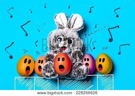 Easter Bunny And Eggs Sing In The Choir