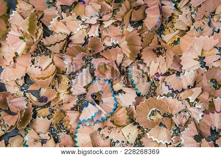 Background Of Multicolor Pencil Shavings. Close Up Colorful Pencil Shavings For Background. Dynamic,