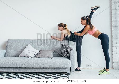 Fit Girls Preparing Legs Workout. Leg Stretching Exercise Fitness Woman Doing Warm-up, Hamstring Mus