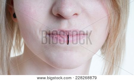 Pierced Female Lips With Vertical Labret Piercing Or Lip Ring On Middle Lower Lip