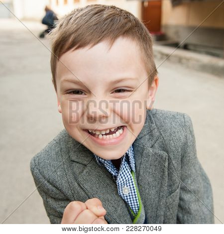 Funny Little Kid Wearing Jacket Threatening With His Fist