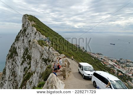 Gibraltar - August 29, 2017: The Rock Of Gibraltar And Strait Of Gibraltar, African Coast In The Dis