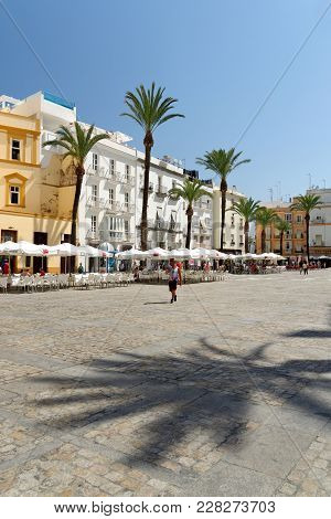 Cadiz, Spain - August 31, 2017: Tourists Relaxing At Pavement Cafes On Cathedral Square.