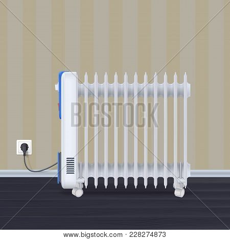 Oil Radiator In Room With Wallpaper On Backdrop. White, Electric Oil Filled Heater On Wheels. Domest