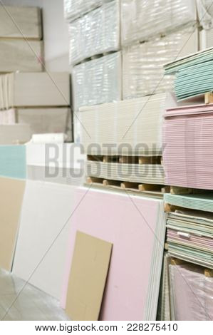 Warehouse With Plasterboard. Sheets Of Plasterboard On Pallets