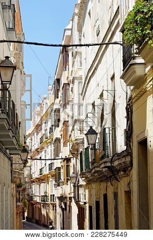 A Typical Old Narrow Street In The Historical Town Of Cadiz, Spain