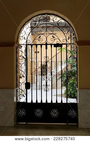 A Beautiful Doorway And Gate In Old Towm Cadiz, Andalusia, Spain.