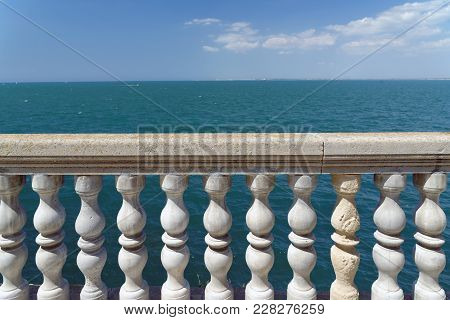 Beautiful White Railing Against The Sea And Sky Background.