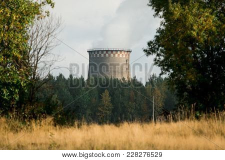 Coal Fired Power Station With Cooling Tower Releasing Steam Into Atmosphere.