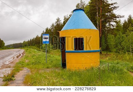 Iron Bus Stop On The Road In The Forest