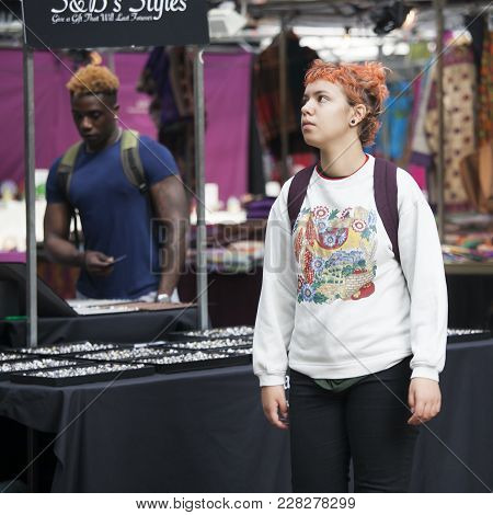 London, England - August 22, 2017 Buyers On The Spitalfields Market Choose Clothes