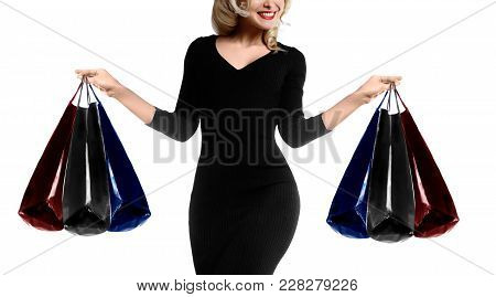 Shopping Young Woman Holding Bags Isolated On White Studio Background. Love Fashion And Sales. Happy