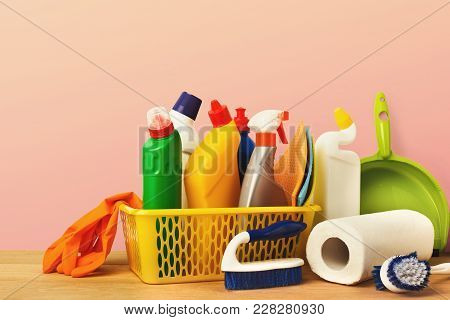 Bucket With Cleaning Items On Wood Table, Closeup. Bucket, Brush, Rubber Gloves, Disinfection Produc