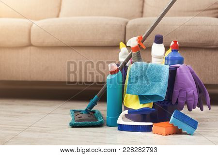 Bucket With Sponges, Chemicals Bottles, Mopping Stick, Rubber Gloves, Brushes And Towel. Household E