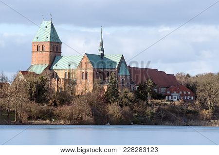 Cathedral Or Dom Of Ratzeburg Seen From The Domsee Lake In Winter, An Historic Brick Romanesque Buil