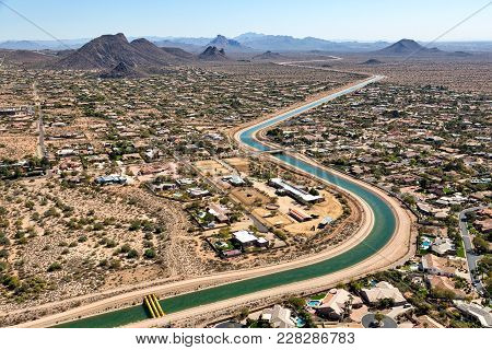 Helicopter View Of Irrigation Water Flowing Through A Scottsdale, Arizona Suburb Looking To The Sout