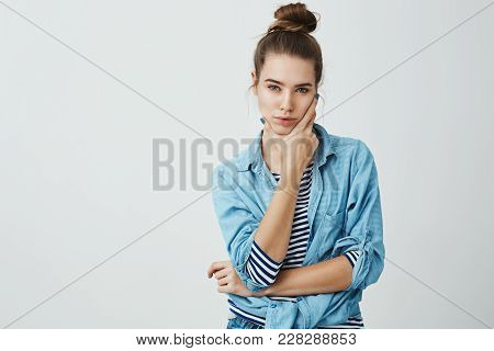 Creative Businesswoman Thinking About New Concept. Studio Shot Of Charming Feminine Girl In Modern T