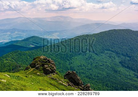 Grassy Hillside Over The Cliff In Mountains. Magnificent Borzhava Mountain Ride In The Distance. Vie