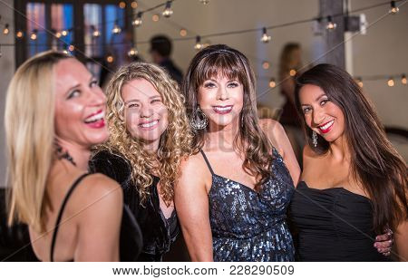 Four Mature Women Smiliing At A Party
