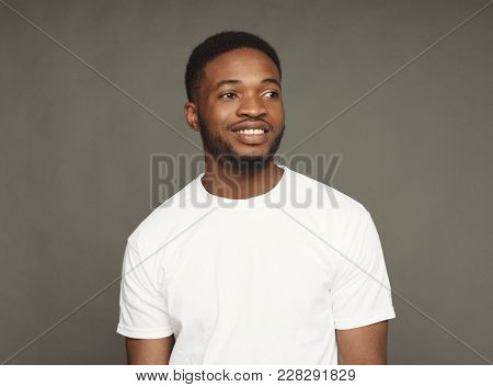 Welcoming Smile. Black Man Smiling On Grey Background, Studio Shot, Copy Space