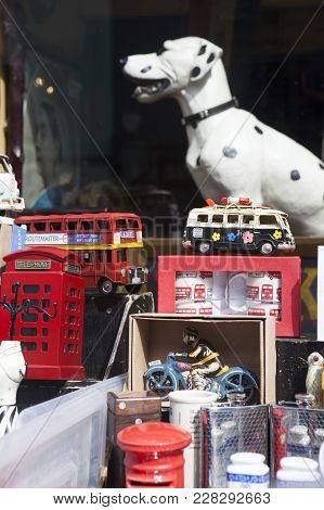 London, England - July 12, 2017 Many Collectable Old Toy Vehicles In Bright Colors On Display In A W