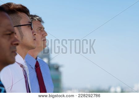 Team Of Ambitious Multiethnic Business People Looking At The Sky