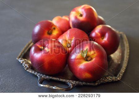 Fresh Ripe Nectarines On Vintage Plate, Dark Background