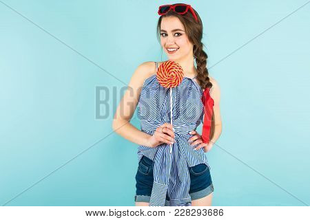 Close Up Portrait Of Brunette Young Pin-up Woman In Striped Shirt And Jeans With Sunglasses Isolated