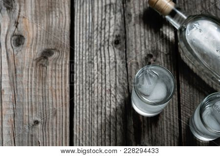 Two Shot Glasses With Cold Vodka Or Gin On Wooden Table, Copyspace