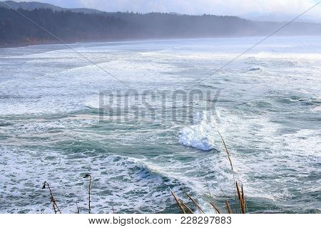 Rolling Waves Entering A Large Cove On The Coast Of Oregon.