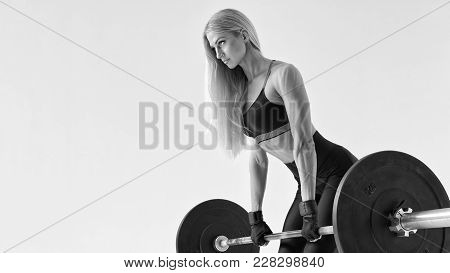Black And White Photo Of Young Woman Doing Weight Lifting Workout Confidently Looking Forward Attrac