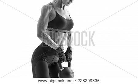 Fit Caucasian Fitness Female Model Doing Physical Workout With Kettle Bell Black And White Cropped S