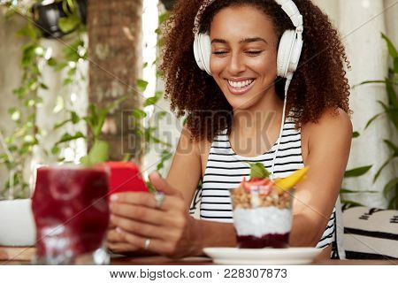 Positive Hipster African American Girl Searches New Music Songs, Happy To Reicieve Message On Cell P