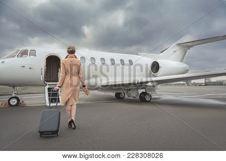Full Length Female Keeping Baggage While Going To Private Jet. She Turning Back To Camera. Trip Conc