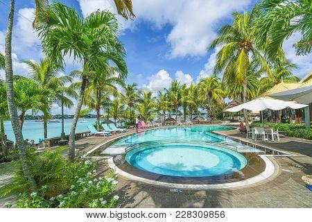 Grand Baie, Mauritius - February 18, 2018: Luxury Resort With Swim Pool At Grand Baie Village On Mau