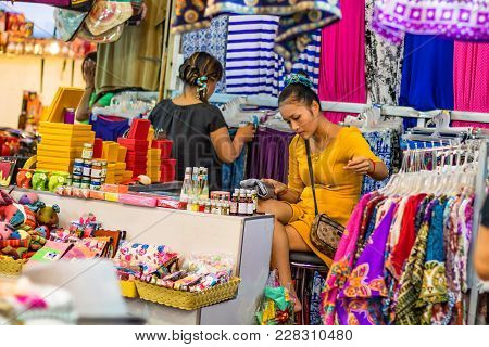 Siem Reap, Cambodia- March 22, 2013: Unidentified Young Khmer Women Selling Clothes At Market In Cam