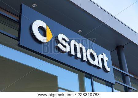 Fuerth / Germany - February 25, 2018: Smart Logo On A Car Dealer Building. Smart Is A German Automot