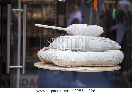 London, England - August 25 2017 A Tank Sewed From White Matter Is Exhibited In A Shop Window On Car