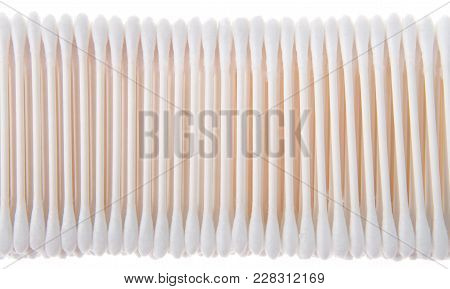 Cotton Swabs On Sticks Stacked And Lined Up In A Row. Isolated On White Background. Commonly Used In