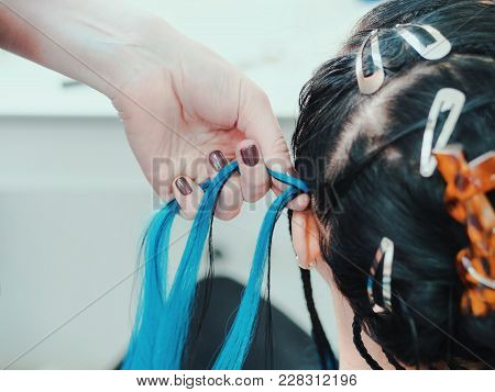 Process Of Weaving African Braid With Kanekalon. Small Afrobraids With Blue Strands. Topical Hairsty
