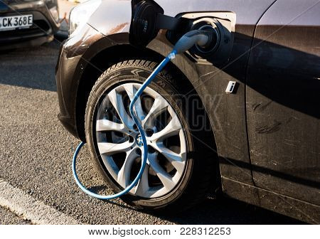 Ostfildern, Germany - February 24, 2018: A Bmw I Electric Car Is Being Charged At A Power Charging S