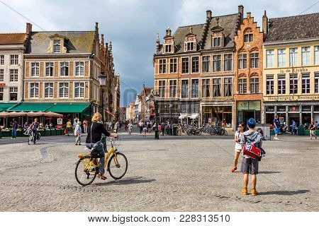 Bruges, Belgium - June 10, 2014: View Of People Riding Bicycles In Bruges, Belgium. Bruges Is The Ca