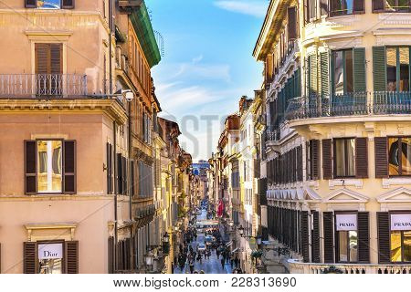 Rome, Italy - January 20, 2017 Via Condotti Famous Shopping Street Rome Italy.  Narrow Street With M