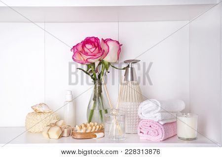 Spa Bath Cosmetic And Flower Rose. Aromatherapy With Natural Oil And Candle. Hygiene And Relaxation
