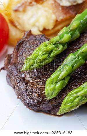 Beef Steak And Green Asparagus On A Plate