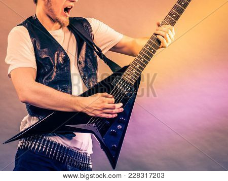 Man Playing Rock On Electric Guitar